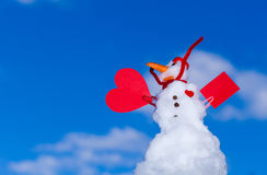 Little happy christmas snowman red heart paper card outdoor. Winter. Royalty Free Stock Image