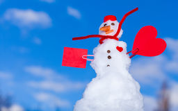 Little happy christmas snowman red heart paper card outdoor. Winter. Royalty Free Stock Photo