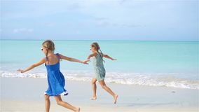 Little happy funny girls have a lot of fun at tropical beach playing together. Little girls having fun at tropical beach playing together. Adorable little stock footage