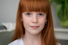 Little happy ginger girl with freckles Royalty Free Stock Images