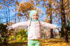 Little happy girl in autumn park Stock Photo