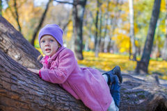 Little happy girl in autumn park Royalty Free Stock Photos