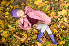 Little happy girl in autumn park on sunny fall day Royalty Free Stock Photography