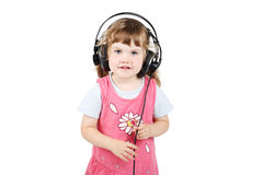 Little happy girl in big headphones Royalty Free Stock Photography