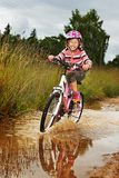 Little happy girl on bike Stock Photo