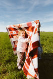 Little happy girl with blanket Stock Photo