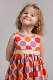 Little happy girl in a bright dress Royalty Free Stock Images