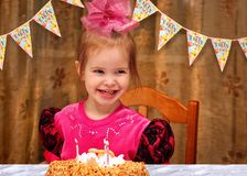 Little Happy Girl Celebrating Her Birthday At The Festive Dinner Royalty Free Stock Photo