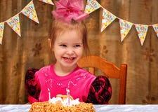 Little happy girl celebrating her birthday at the festive dinner