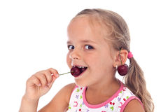 Little happy girl with cherry earrings Stock Photos