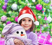 Little happy girl on Christmas party Royalty Free Stock Photos
