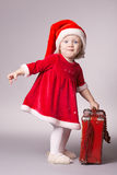 Little happy girl with christmas suitcase Royalty Free Stock Images