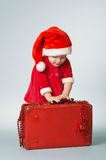 Little happy girl with christmas suitcase Stock Images