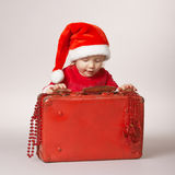 Little happy girl with christmas suitcase Royalty Free Stock Photo