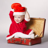 Little happy girl with christmas suitcase Royalty Free Stock Image