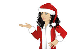 Little happy girl  in a costume of Santa Claus. And advertising something empty in the hands on white background. Portrait of a child isolated on white Royalty Free Stock Image