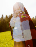 Little happy girl covered herself blanket Royalty Free Stock Photos
