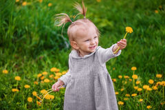 Little happy girl with dandelions Royalty Free Stock Photos
