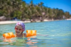 Little happy girl with diving in the sea and Royalty Free Stock Photo