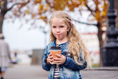 Little happy girl drinking cocoa Royalty Free Stock Images