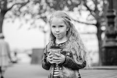 Little happy girl drinking cocoa Stock Photography