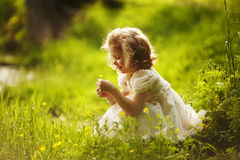 Little happy girl with a flower Royalty Free Stock Photo
