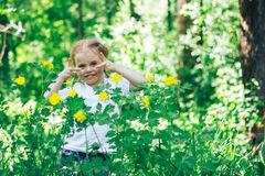 Little happy girl in forest look at camera Royalty Free Stock Photos