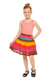Little happy girl full lenght in colorful skirt, isolated on white background Stock Images