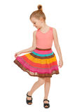Little happy girl full lenght in colorful skirt, isolated on white background Royalty Free Stock Photography