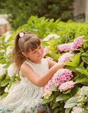 Little happy girl in garden Stock Photo