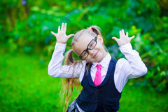 Little happy girl going back to school outdoor Royalty Free Stock Image