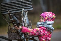 Little  happy girl with hand feeding a squirrel in the Park. Little girl with hand feeding a squirrel in the Park Royalty Free Stock Photography