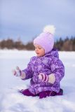 Little happy girl having fun on the snow at winter Royalty Free Stock Images