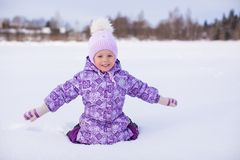 Little happy girl having fun on the snow at winter Royalty Free Stock Photo