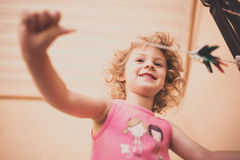 Little happy girl having fun Royalty Free Stock Image