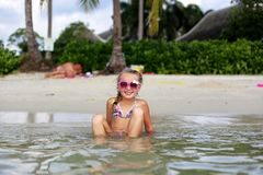 Free Little Happy Girl In Sunglasses And A Swimsuit In The Sea. Concept Of Relaxation And Vacation Royalty Free Stock Photos - 155893828