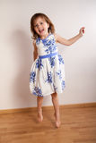 Little happy girl jumping Royalty Free Stock Images