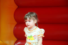 Little happy girl jumps on bouncy castle Royalty Free Stock Photo