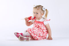 Little happy girl with lollipop Royalty Free Stock Images