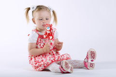 Little happy girl with lollipop Stock Photos