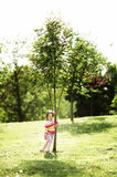 Little happy girl near the tree Royalty Free Stock Images