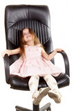 Little happy girl on office chair Stock Photo