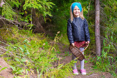 Little happy girl pick up mushrooms in autumn Royalty Free Stock Photo