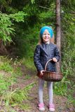 Little happy girl pick up mushrooms in autumn stock images