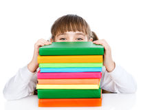 Little happy girl with pile books. isolated on white background stock photo
