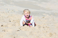 Little happy girl playing on the beach Royalty Free Stock Image