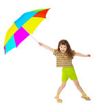 Little happy girl is playing with color umbrella Royalty Free Stock Images