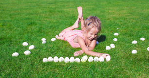 Little happy girl playing with Easter eggs on Royalty Free Stock Photo