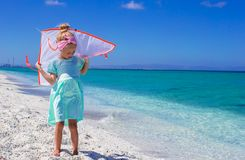 Little happy girl playing with flying kite on Royalty Free Stock Photography