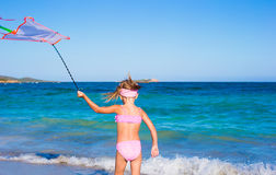 Little happy girl playing with flying kite during Royalty Free Stock Photography